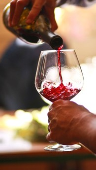 pouring a glass of Pinot